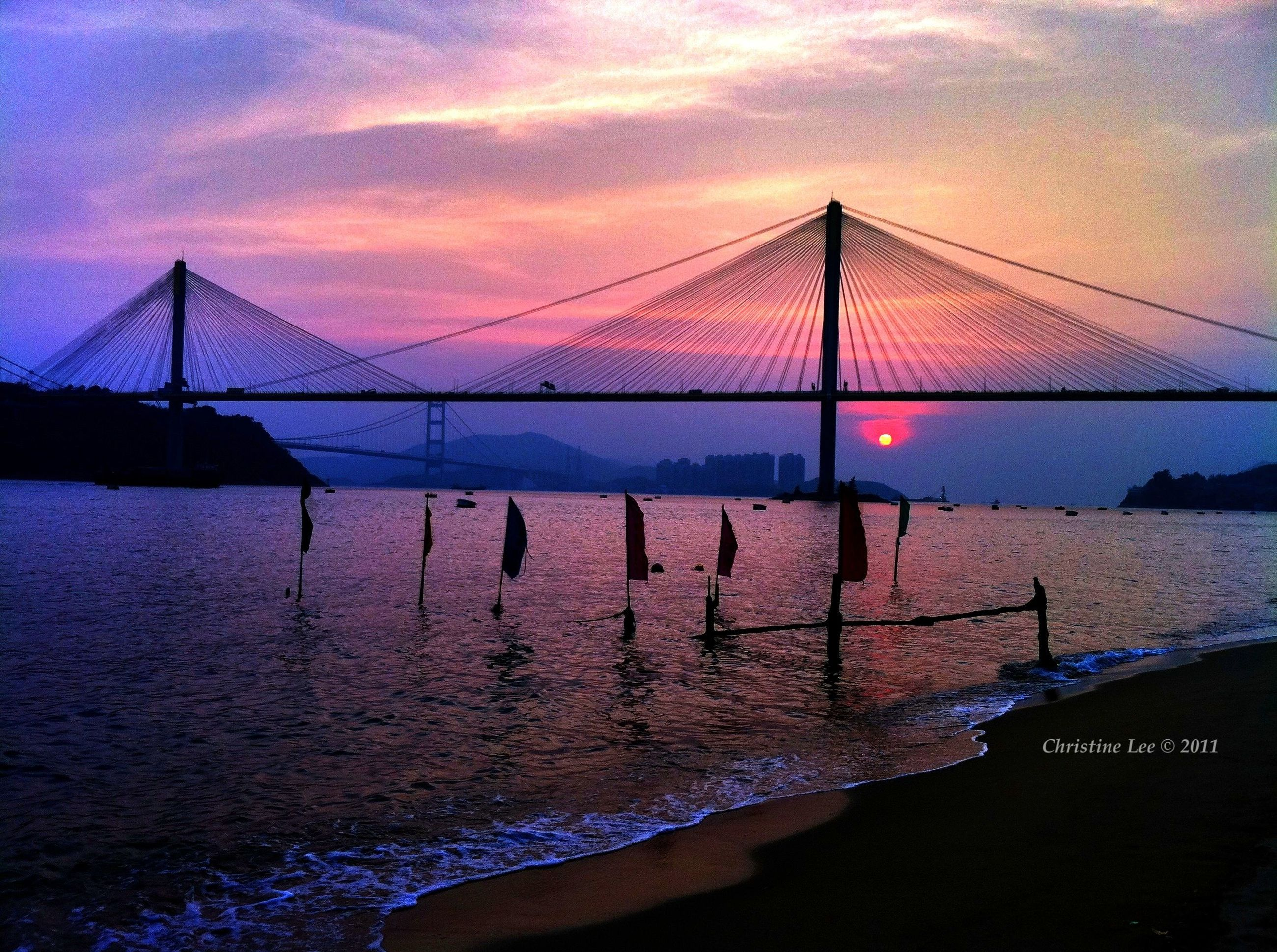 sunset, water, connection, sky, bridge - man made structure, sea, suspension bridge, tranquil scene, tranquility, scenics, built structure, engineering, beauty in nature, silhouette, reflection, bridge, cloud - sky, nature, architecture, orange color