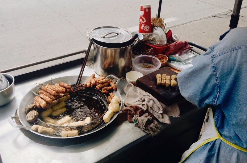 High angle view of man preparing food on street
