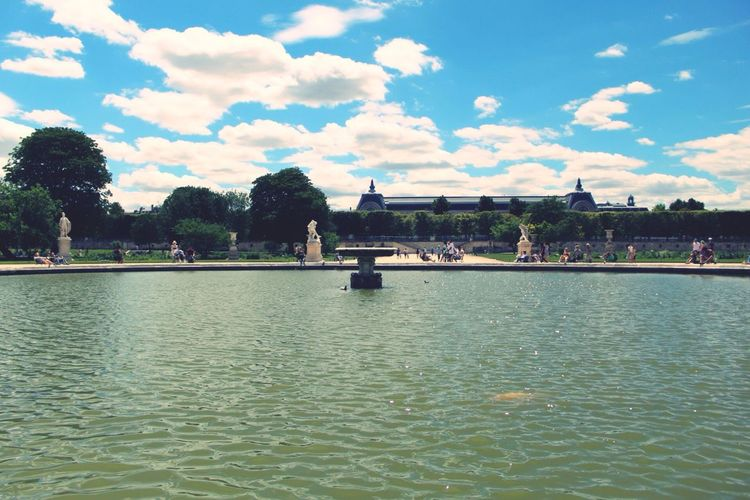 Architecture Water Built Structure Sky Cloud - Sky Day Waterfront Building Exterior River Outdoors Travel Destinations Tree Large Group Of People Nature People Parcdestuileries Parc Des Tuileries