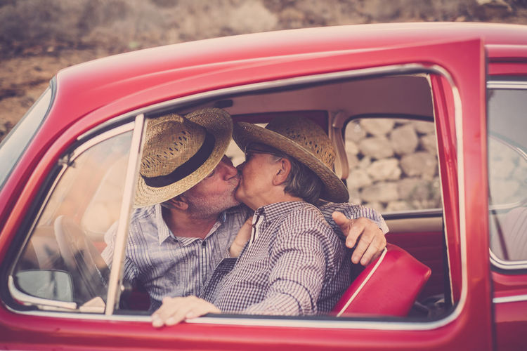 Senior Couple Kissing In Car