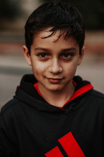 Close-up portrait of boy smiling