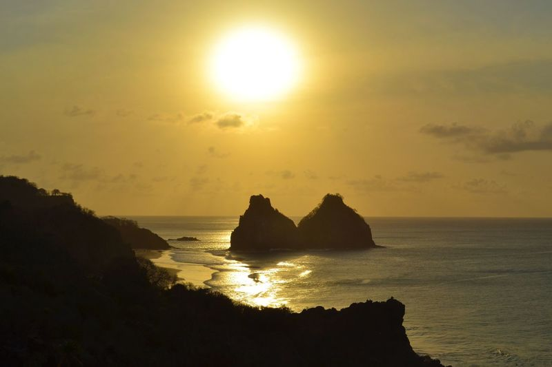 Sea Sunset Beauty In Nature Nature Sun Scenics Water Horizon Over Water Rock Formation Rock - Object Silhouette Sunlight Beach Landscape Archipelago Two Brothers Rock Two Brothers In Fernando De Noronha Sunset_collection Sunset Silhouettes in Fernando De Noronha Island Fernando De Noronha Brazil
