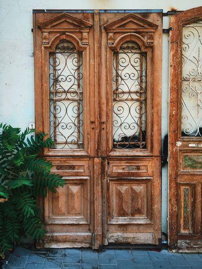 Old wooden doors of building