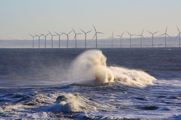 Alternative Energy Beauty In Nature Day Fuel And Power Generation Horizon Over Water Motion Nature No People Outdoors Power In Nature Sea Sky Water Waterfront Wind Power Wind Turbine Windmill