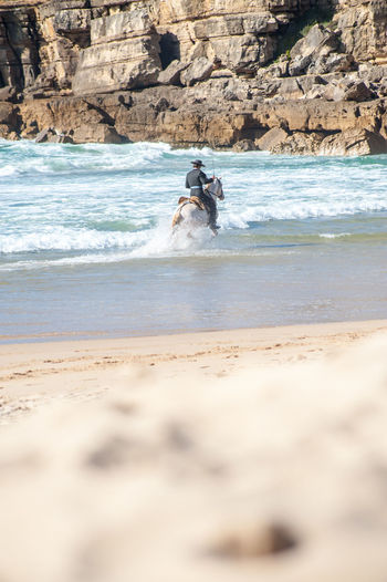 Horse riding for a photo shooting Sea Beach Land Water Motion Sand Sport Wave Day Real People Full Length People Leisure Activity Men Beauty In Nature Nature Aquatic Sport Holiday Surfing Outdoors Horse Riding Horse