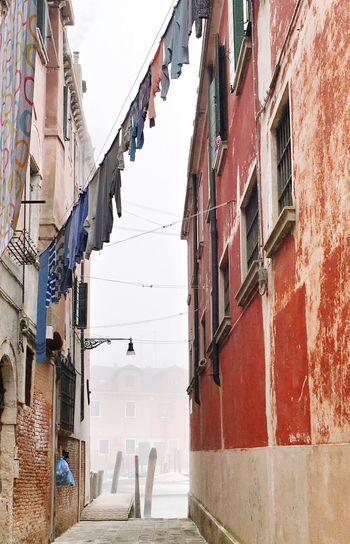 Building Exterior Architecture Laundry Clothesline Built Structure Residential Building Clothing House Outdoors Hanging Drying Sky Low Angle View Day No People Balcony Wall Lamp Venice, Italy Fog Foggy Morning Canals And Waterways Wall Winter
