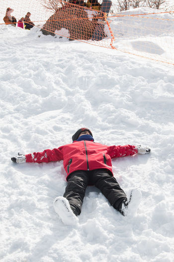 High angle view of person in snow on land