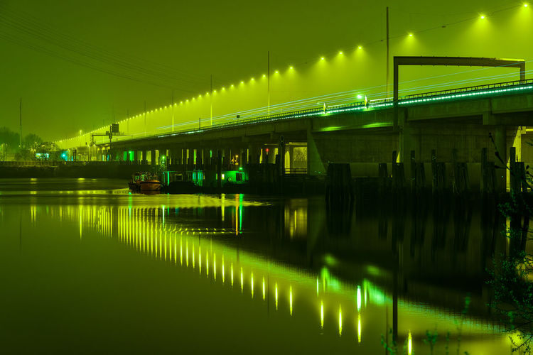 street light Reflections In The Water Hamburg Harbor Lantern Calm Water Green Light Freeway Long Exposure Nikonphotography Reflection Illuminated Water Night Transportation Waterfront Green Color No People Built Structure Lighting Equipment Architecture Connection Glowing Nature Outdoors Bridge River Light Mode Of Transportation