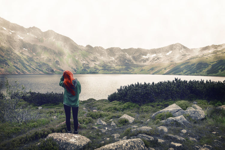 Not from this reality. Adventure Dengler Full Length Hike Lake Landscape Lifestyle Matthias Mountain Mountain Range Mountaineering Mountains Nature One Woman Only Only Women Outdoor Outdoors People Rear View Snapshopped Standing Tatras Travel Travel Destinations Water
