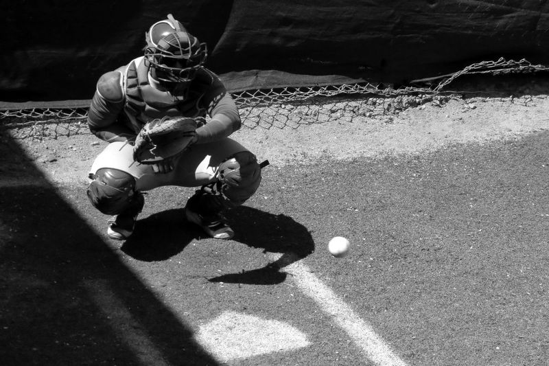 Ball moving towards baseball catcher