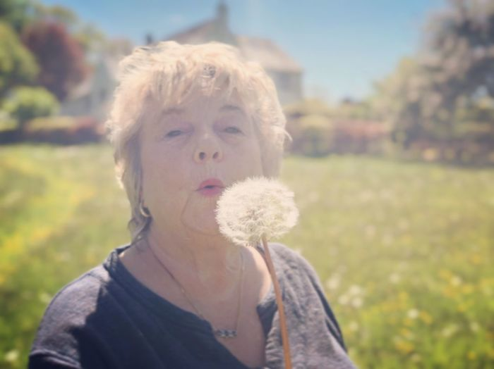 Dandelion what's the time? Summer Sunshine Mystical Magical Garden Devon Headshot Focus On Foreground Real People Portrait Leisure Activity One Person Day Lifestyles Nature Blond Hair Plant Hair Women Females Sunlight Field Hairstyle Young Adult Outdoors