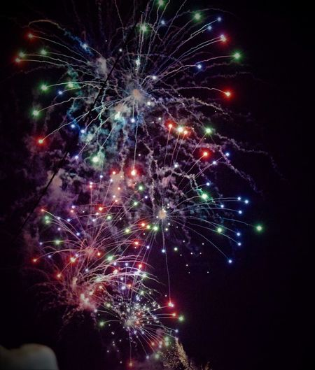 Night Firework Display Celebration Exploding Illuminated Long Exposure Motion No People Multi Colored Arts Culture And Entertainment Firework - Man Made Object Sky Outdoors Firework Beauty Scenics