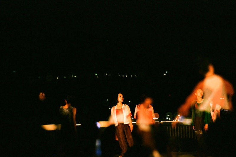 People enjoying illuminated at night