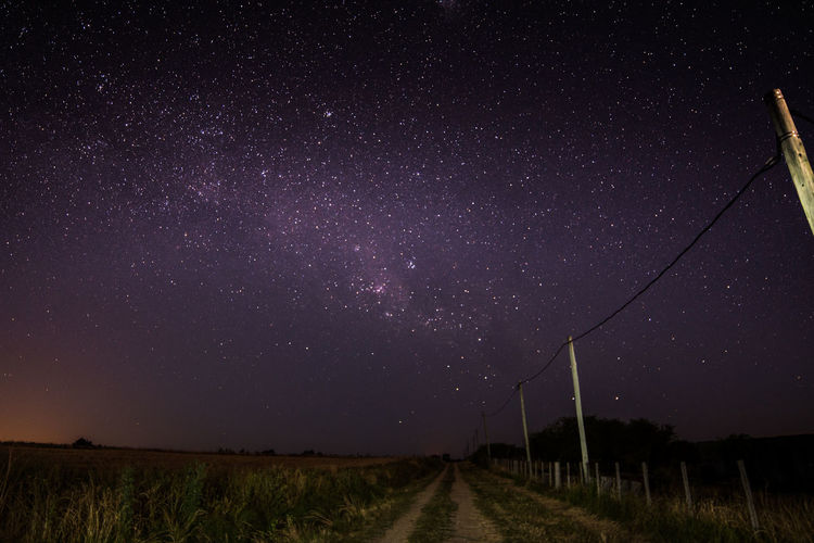 Night Star - Space Landscape Tranquil Scene Scenics Nature Astronomy Beauty In Nature Field No People Outdoors Sky Rural Scene Milky Way Galaxy