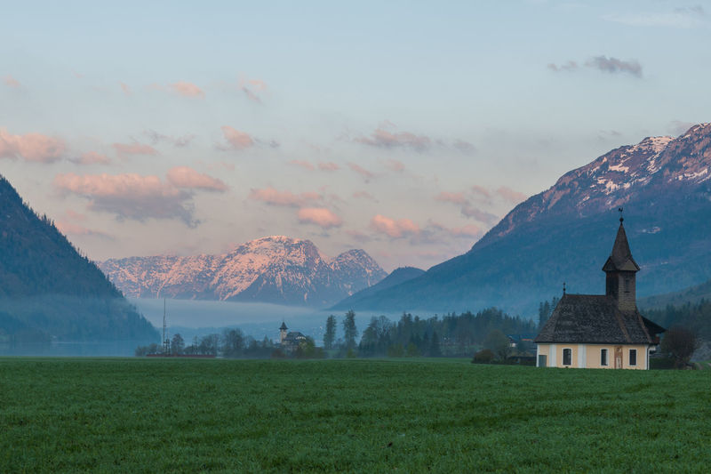 Grundlsee Architecture Beauty In Nature Building Building Exterior Built Structure Cloud - Sky Environment Grass Landscape Mountain Mountain Peak Mountain Range Nature No People Outdoors Place Of Worship Plant Religion Scenics - Nature Sky Tranquil Scene