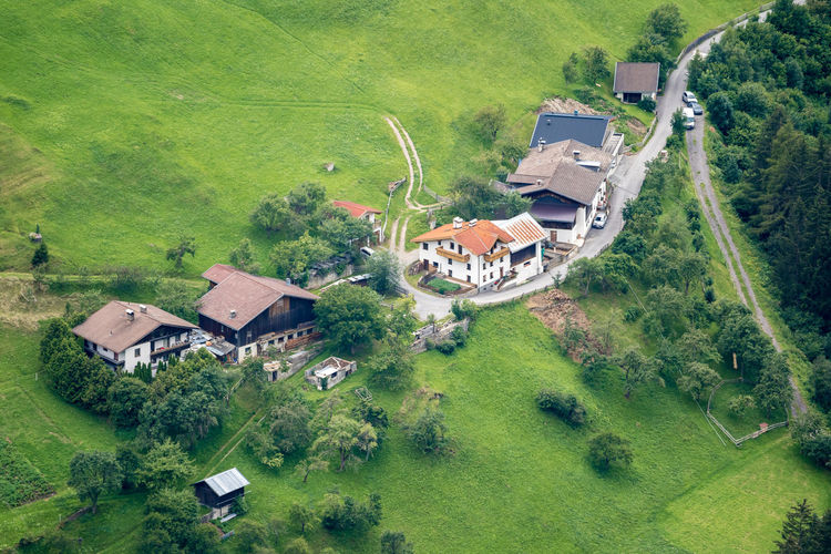 High angle view of houses and agricultural field