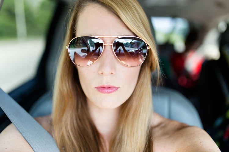 Selfie of a woman wearing sunglasses while in a car Sunglasses Glasses One Person Portrait Headshot Focus On Foreground Woman Selfie Selfie Portrait Selfie Of Woman Car Interior Vehicle Interior Summer Summertime
