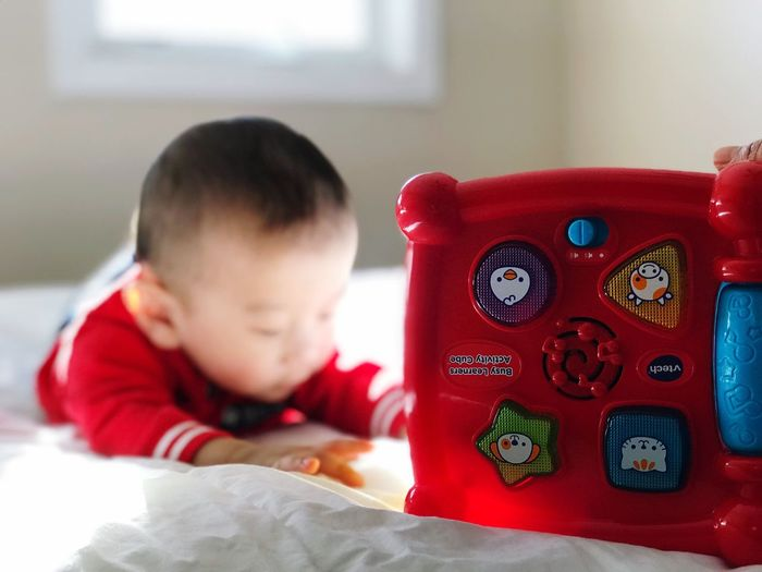 Indoors  One Person Childhood Boys Real People Lifestyles Communication Home Interior Bed Domestic Life Bedroom Telephone Technology One Boy Only Day Close-up Human Hand People