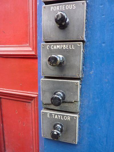 Edinburgh doorbells Red Close-up Closed Security Metal Blue Yellow In A Row Full Frame Vibrant Color No People Edinburgh Doorbells