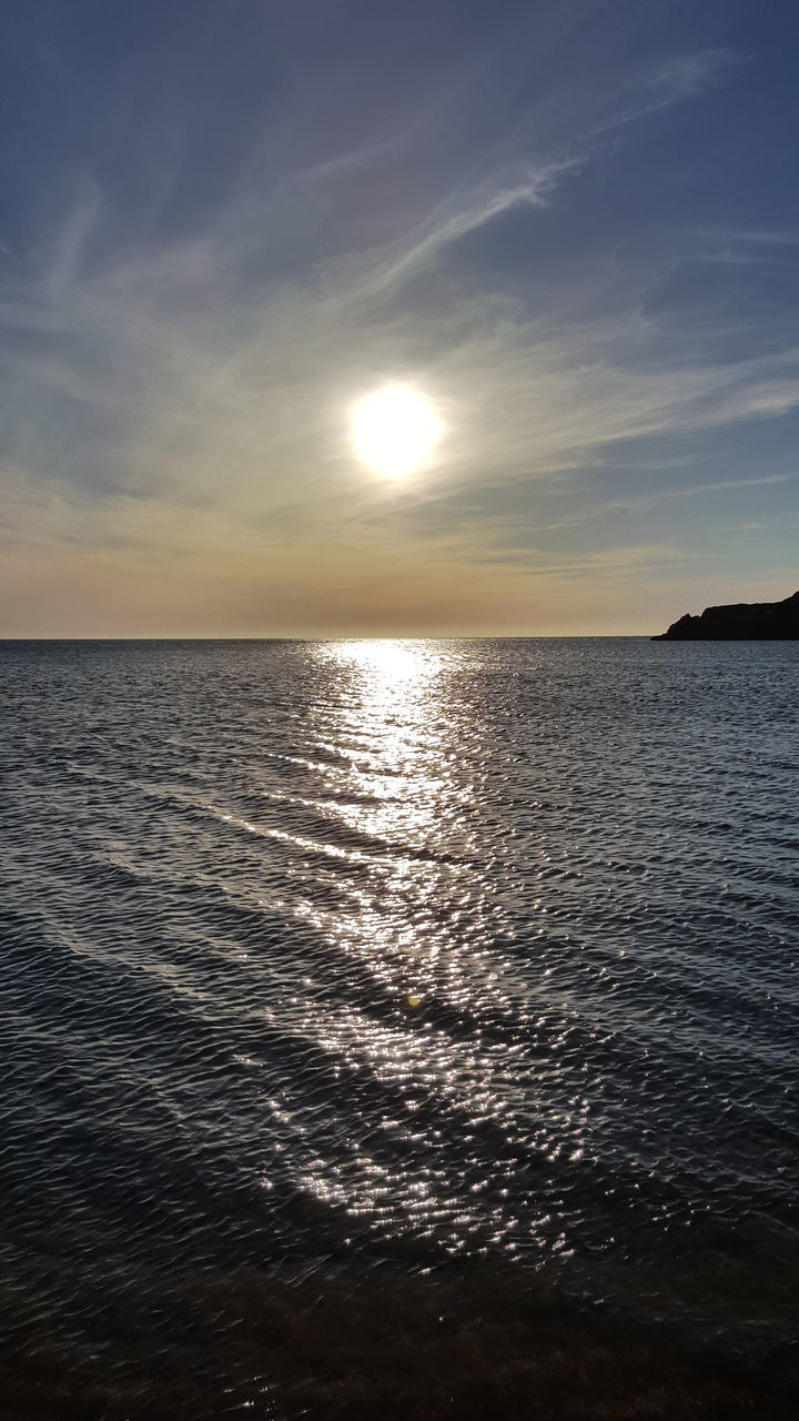 sea, sunset, water, scenics, beauty in nature, tranquil scene, nature, tranquility, sun, idyllic, reflection, sky, horizon over water, waterfront, no people, sunlight, rippled, outdoors, beach, day