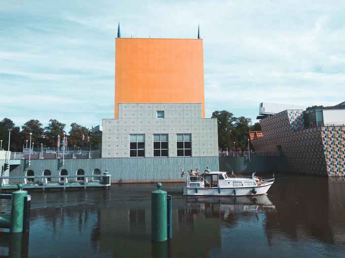 Groninger Museum. Museum Minimalist Architecture Simplicity The Great Outdoors - 2018 EyeEm Awards Water City Reflection Flag Sky Architecture Cloud - Sky Building Exterior Boat