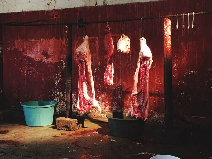 Meats Hanging At Butcher Shop