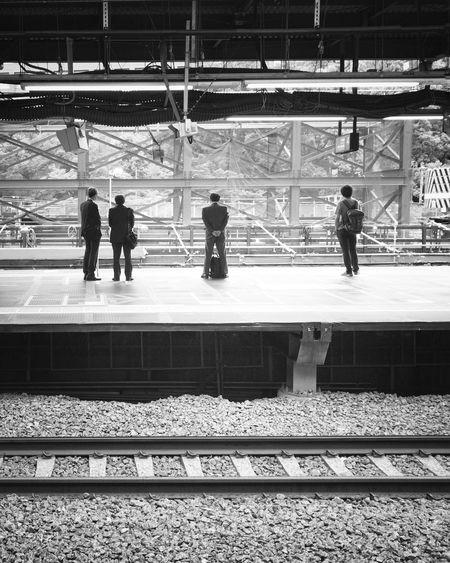 Railroad Station Real People Blackandwhite Railroad Station Platform Public Transportation People Railroad Track Men Rear View