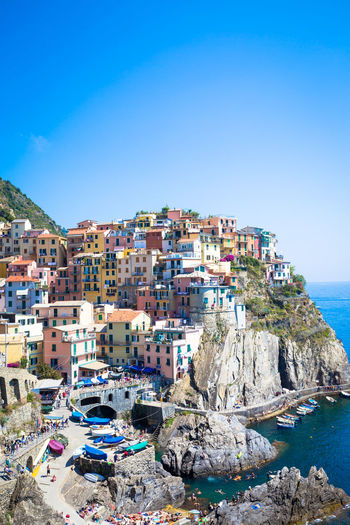 Architecture Beauty In Nature Blue Building Exterior Built Structure City Cityscape Coastline Day Nature No People Outdoors Residential Building Residential District Residential Structure Rock - Object Rock Formation Scenics Sea Sky Town TOWNSCAPE Tranquility Travel Destinations Water