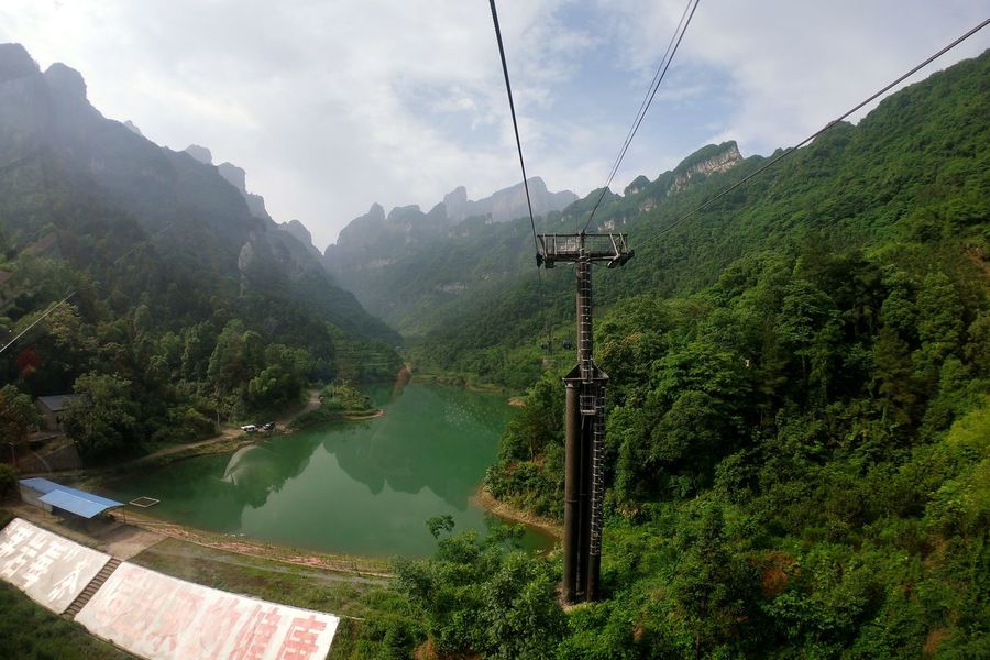 Cable Car to the mountain Tianmen Mountain China Panorama Cable Car Mountain Water Overhead Cable Car Tree Sky Foggy Valley Mountain Road