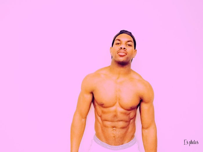 Violet Only Men One Man Only Shirtless Muscular Build Adults Only One Person Handsome Athlete Studio Shot Sportsman Adult Lifestyles Smiling One Young Man Only People Beautiful People Pink Color Portrait Human Body Part Men