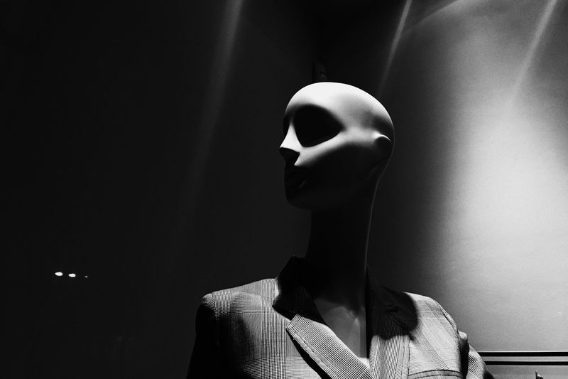 Close-up of mannequin against wall