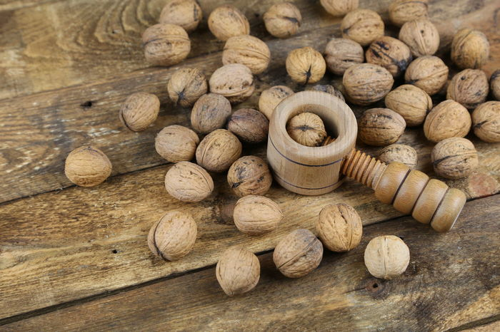 Abundance Background Brown Close-up Day Food Food And Drink Freshness Healthy Eating High Angle View Indoors  Large Group Of Objects No People Nut Cracker Nutshell Postcard Stack Walnuts Wood Wood - Material