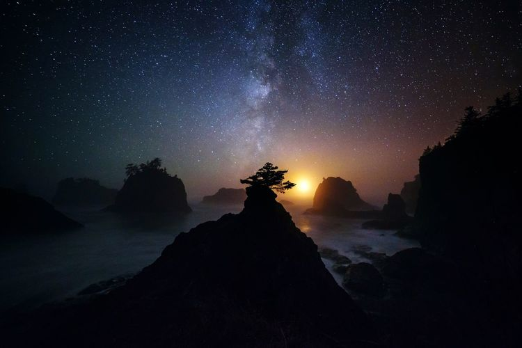As the moon set, what little light had been illuminating the waves crashing below me faded leaving their low and rhythmic rumble as the only evidence of their existence. Pacific Northwest  PNW EyeEmNewHere Oregon Coast Oregon Beauty In Nature Tranquil Scene Tranquility Nature Scenics Sky Rock - Object Night Silhouette Outdoors No People Star - Space Sea Water Physical Geography Astronomy Landscape Milky Way Mountain Galaxy