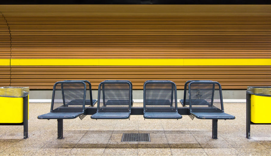 Empty chairs at subway station