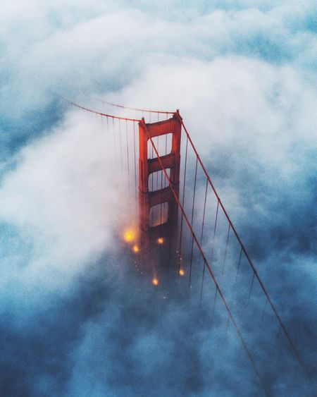 Aerial view of suspension bridge in foggy weather