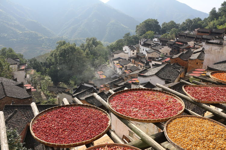 High angle view of spices in plates on bamboo structure at town