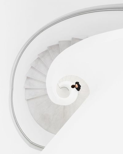 High angle view of person standing on staircase