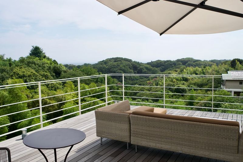 Absence Architecture Balcony Beauty In Nature Chair Cloud - Sky Coffee Table Day Empty Furniture Nature No People Outdoors Plant Railing Seat Sky Table Tranquility Tree Wood - Material
