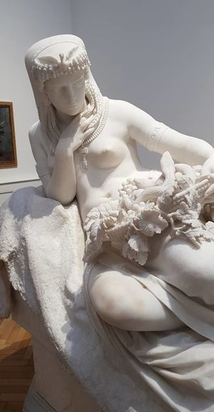 Close-up of white statue in museum