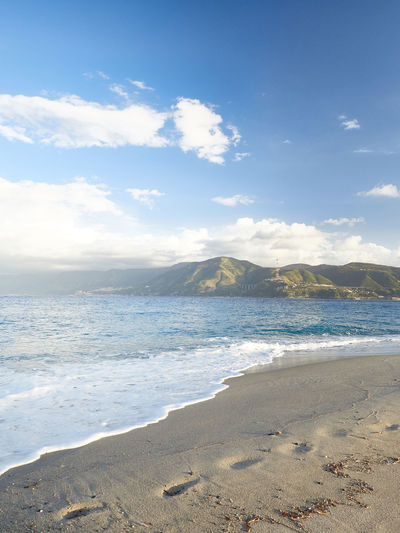 Messina beach with the Calabrian coast in front. Messina Sicily Mediterranean Sea Sky Beach Water Sea Land Beauty In Nature Cloud - Sky Scenics - Nature Sand Tranquil Scene Tranquility Nature Mountain No People Idyllic Motion Outdoors Day Wave Non-urban Scene
