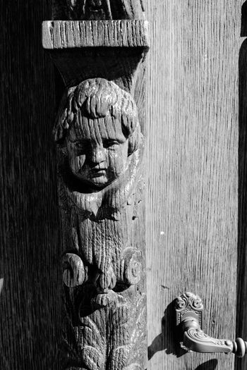 Close-up Art And Craft Art Human Representation Creativity Plank Person Day Outdoors History No People Memories Carved Carved Wood Carved Wooden Figure Close-up Shot Close Up Detail Photography Detail Old Carving ArtWork Carved In Wood