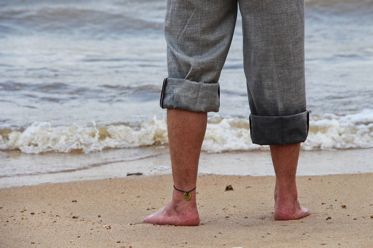 Adult Adults Only Ankle Deep In Water Beach Close-up Day Human Body Part Human Leg Low Section Men Nature One Person Outdoors People Real People Sand Sea Standing Vacations Walking Water Wave