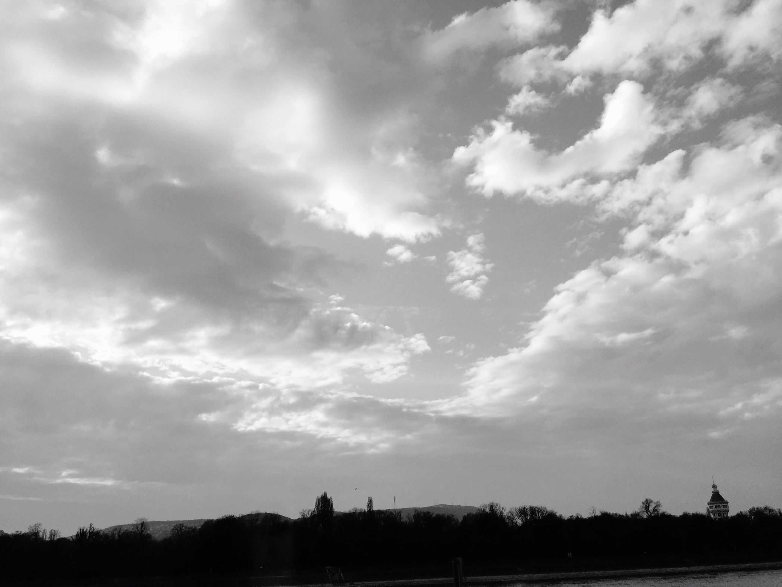 sky, cloud - sky, tranquility, tranquil scene, cloudy, silhouette, landscape, scenics, beauty in nature, field, cloud, nature, tree, outdoors, idyllic, weather, overcast, day, non-urban scene, horizon over land