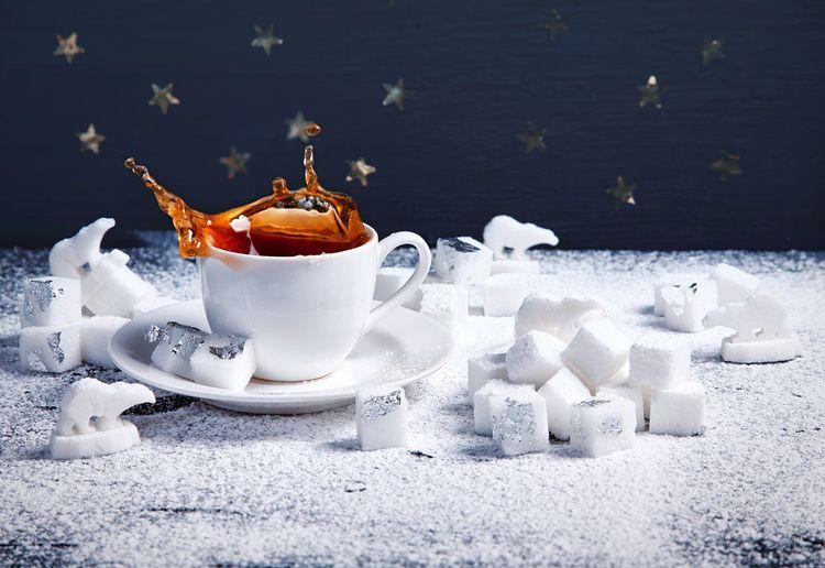 Close-Up Of Splashing Coffee In Snow