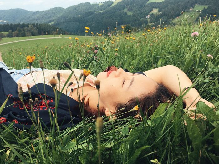Grass Lying Down Rural Scene Field Relaxation One Person Outdoors Nature Adults Only Day Adult Only Women Leisure Activity Young Adult People Plant One Woman Only Women Young Women Human Body Part