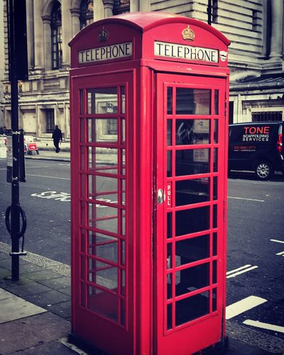 Telephone Booth Red Communication Pay Phone Street Text Telephone Building Exterior Connection Architecture Outdoors Day Built Structure No People Old-fashioned Road Technology City Close-up Postcode Postcards