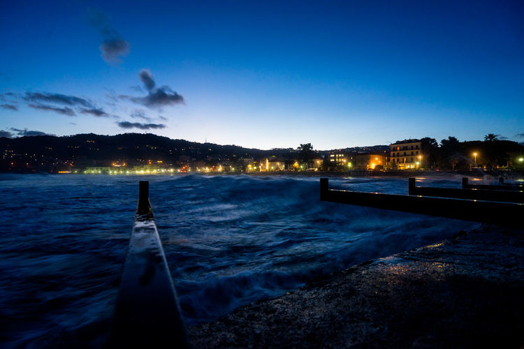 Night view at the seaport of Diano Marina Italy Harbor Pier Architecture Beauty In Nature Blue Building Exterior Built Structure City Cloud - Sky Docking Illuminated Long Exposure Mountain Nature Night No People Outdoors Scenics Sky Tranquil Scene Tranquility Tree Water