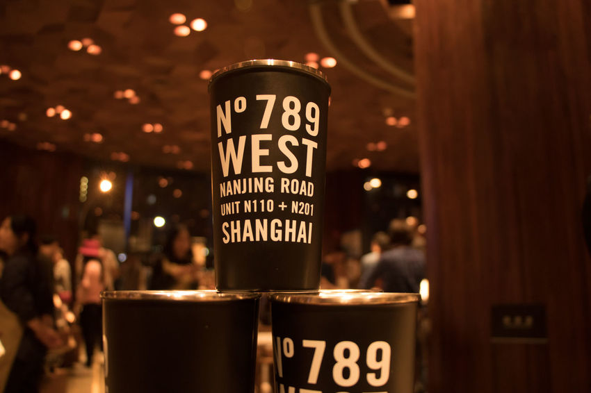 Illuminated Focus On Foreground Text Communication Food And Drink Drink Western Script Refreshment Indoors  Restaurant Script Non-western Script Night Close-up Group Starbucks Reserve Roastery Shanghai Starbucks Coffee Coffee Cup Coffee Mug Display