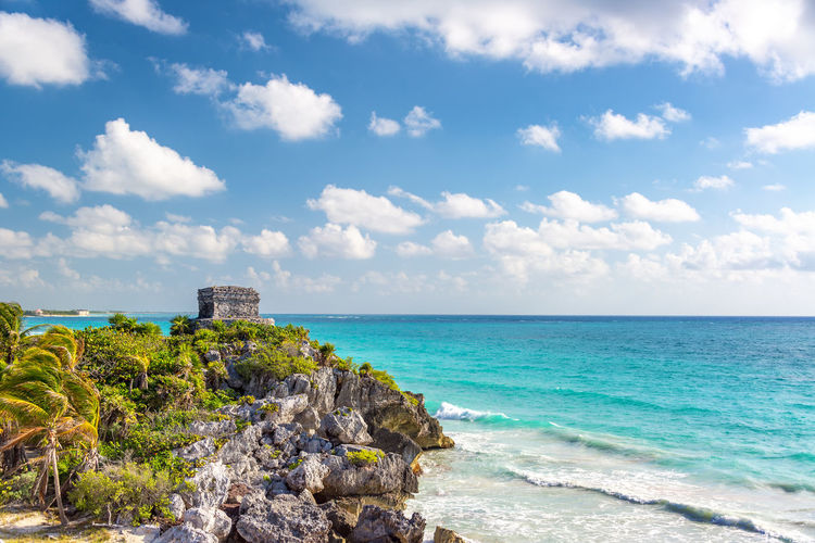 Ancient Mayan ruins in Tulum, Mexico on a cliff overlooking the Caribbean Sea Ancient Cancun Exotic May Mayan Mexico Quintana Roo Riviera Maya Ruins Travel Yúcatan Caribbean Landmark Landscape Mexican Nature Outdoors Peninsula Quintanaroo Riviera Sea Tourism Tropical Tulum Vacation