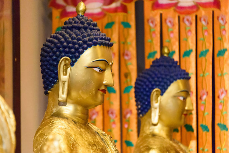 Human Representation Representation Religion Art And Craft Spirituality Sculpture Belief Statue Male Likeness No People Creativity Place Of Worship Gold Colored Indoors  Idol Focus On Foreground Close-up Retail Display Buddha Statue Leshan Sichuan